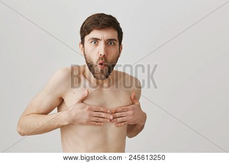Turn Around Don't You See I Am Naked. Funny European Man With Beard Standing Naked Over Gray Backgro