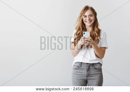 Laughing Over Picture Girl Took. Portrait Of Happy Attractive Caucasian Female Blogger In Glasses An