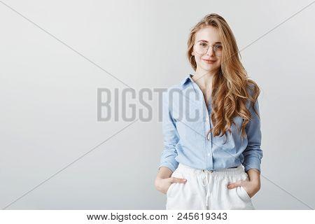 Travel Agent Hearing Customer Desires. Portrait Of Good-looking European Businesswoman In Blue Blous