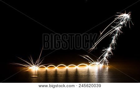 Sparks Bounce And Explode On A Wooden Surface.