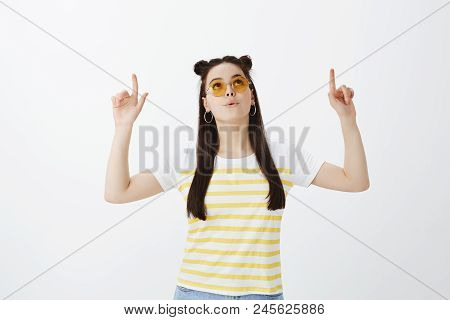 Girl Whisteling From Interest, Being Impressed With Interesting Object, Standing In Sunglasses And T