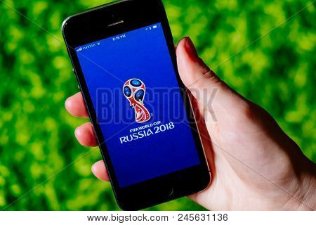 Cologne, Germany - June 17, 2018: Closeup Of Iphone Screen With Football Worldcup 2018 Logo In Russi