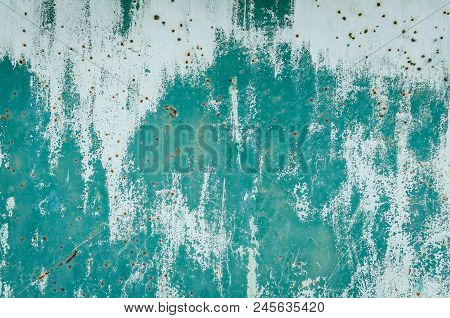 Old Turquoise Worn Metal Surface With Paint Background. Abstract Corroded Colorful Rusty Metal Backg
