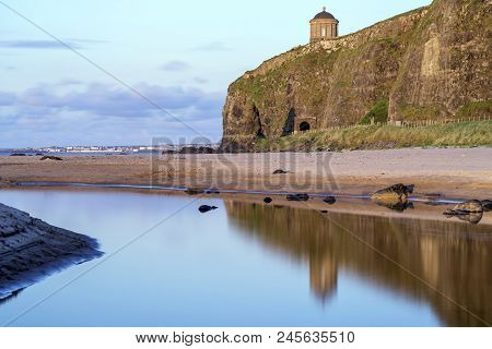 A Reflective View Of The Mussenden Temple At Downhill