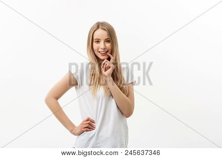 Lifestyle And Emotional Concept: Charming Beautiful Shy Caucasian Woman. Hands Hold Face With Excite