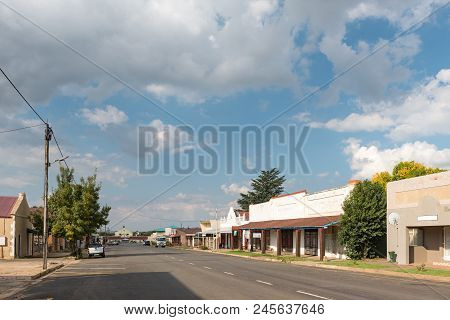 Dewetsdorp, South Africa - April 1, 2018: A Street Scene, With Businesses And Vehicles, In Dewetsdor