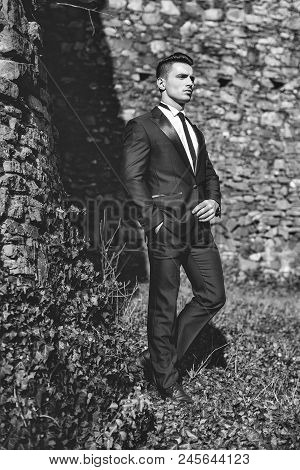 Man In A Suit. Man Half Face Young Handsome Elegant Model In Suit With Skinny Necktie Poses With Han