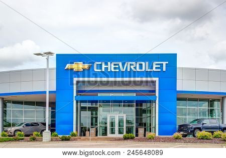 Chevrolet Automobile Dealership Exterior And Trademark Logo