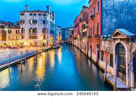 View Over A Picturesque Canal With Beautiful Reflections In Castello District Of Venice, Italy