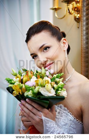 Happy Bride With A Bouquet Of Flowers