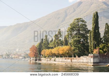 Autumn on Como Lake in Italy. Panoramic View of Shoreline with Town on Background.