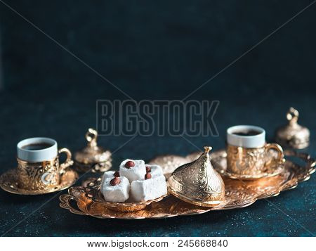 Turkish Coffee With Delight And Traditional Copper Serving Set On Dark Background. Assorted Traditio
