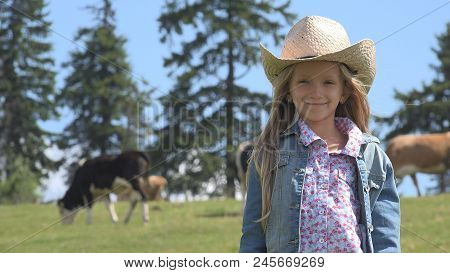 Portrait Of Farmer Child With Cows, Cowherd Little Girl Face Pasturing Cattle