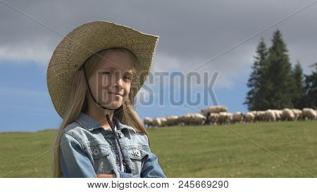 Cowboy Farmer Girl With Sheep In Mountains, Child Portrait Pasturing Animals