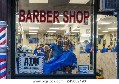 New York, Usa - May 20, 2018: People Getting Haircut In A Barber Shop In New York City.
