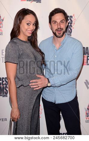 LOS ANGELES - JUN 16:  Amber Stevens West, Andrew J.West at the