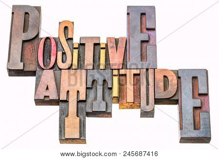 positive attitude - isolated word abstract in vintage letterpress wood type printing blocks stained by color inks