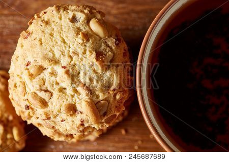 Porcelain Cup Of Black Tea Or Earl Grey And Pile Of Sweet Cookies On Rustic Wooden Background, Top V