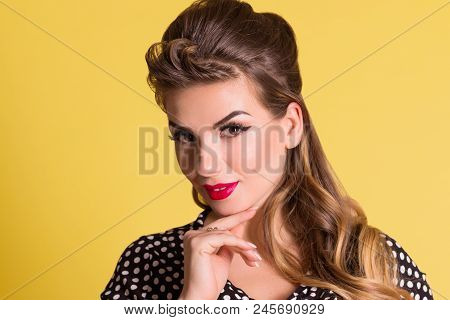 Pretty Woman With Make Up Poses In Yellow Studio, Pin Up Style