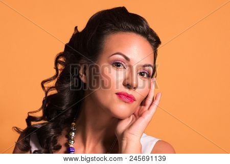 Pretty Young Brunette With Hairdo And Make Up Poses In Studio, Pin Up Style, Close Up Portrait