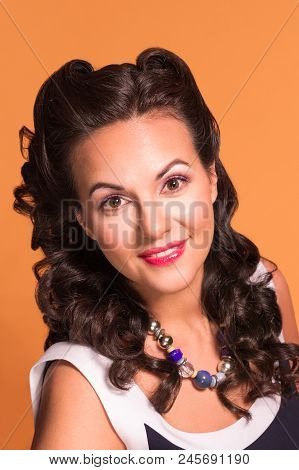 Pretty Brunette With Hairdo And Make Up Poses In Studio, Pin-up Style, Close-up Portrait