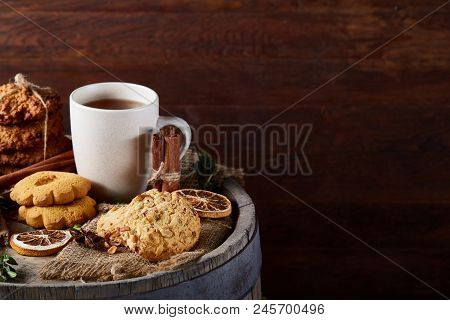 White Porcelain Mug Of Black Tea Or Earl Grey And Pile Of Sweet Cookies On Rustic Wooden Background,