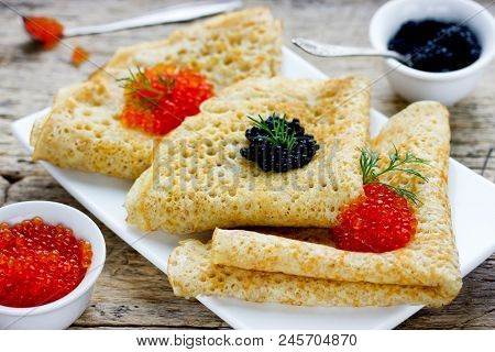 Russian Pancakes With Red And Black Caviar