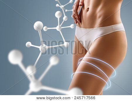 Woman With Perfect Body Near Big Molecule Chain. Slimming Concept. Improvement Of Metabolism Concept