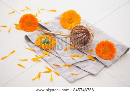 Herbal tea with marigold flowers on the table - herbal medicine