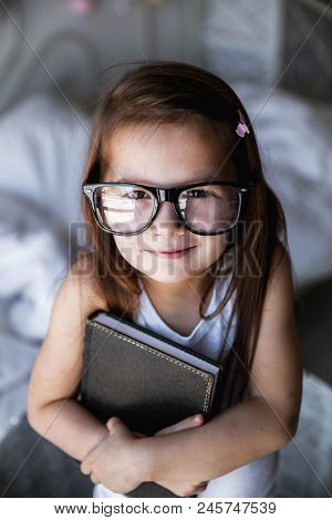 Preschooler Girl With Books And Glasses. Teaching, Student, Education
