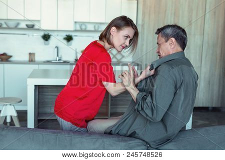 Angry Wife. Furious Stressed Wife Wearing Stylish Red Blouse Feeling Extremely Angry While Looking A