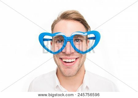 In Love Glance. Man Happy Smiling Blond Blue Eyes In Heart Shaped Eyeglasses Fall In Love. Man Hands