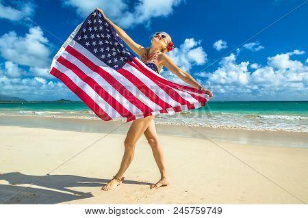 Smiling Woman With American Flag Bikini Waving American Flag In Spectacular Tropical Lanikai Beach,