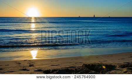 Sunset At The Beach In Barbados Island, Caribbean.  Idyllic Evening At The Beach In Barbados (caribb