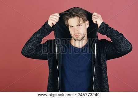 Guy With Bristle In Dark Blue Tshirt And Grey Hoodie. Man With Fair Hair On Purple Background. Macho