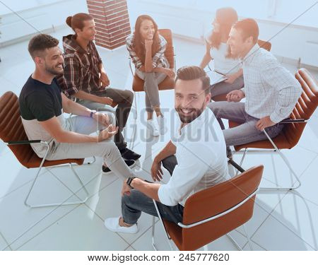 Manager and his team sitting in the office
