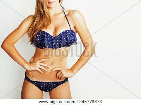 Woman Breast And Belly Part In Purple Bikini Partly On White Background Close Up, Lifestyle People