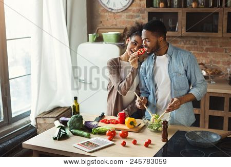 Loving Black Couple Preparing Dinner In Loft Kitchen At Home. Family Cooking Healthy Food Together