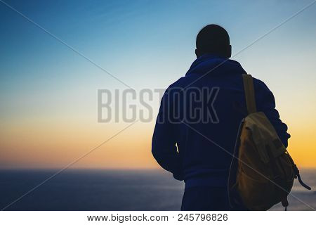 Hipster Hiker Tourist With Backpack Looking Of Amazing Seascape Sunset On Background Blue Sea, Guy E