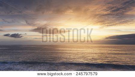 Sunlight Sunset On Horizon Ocean On Background Seascape Atmosphere Rays Sunrise. Relax View Waves Se