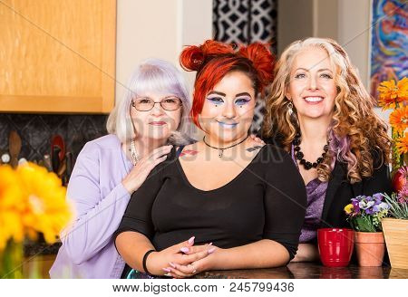 Three Woman Smiling In The Bright Kitchen