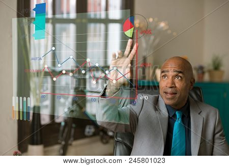 Man Pointing To Pie Chart On A Futuristic Graph