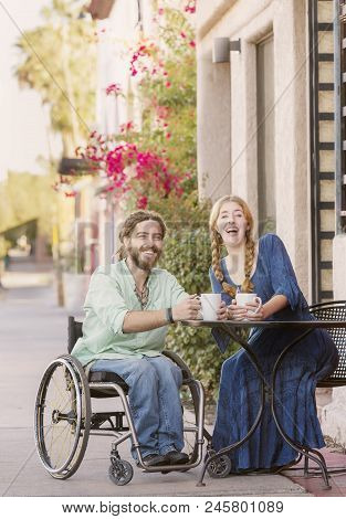 Laughing Woman And Male Friend In Wheelchair