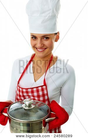 Portrait of happy female with pan looking at camera in isolation