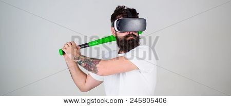 Hipster With Stylish Beard Testing Virtual Reality Gaming Equipment. Gamer With Hipster Beard Playin