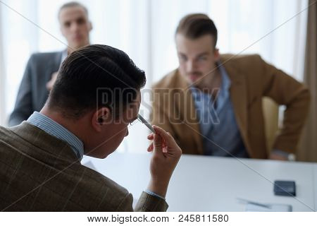 Pensive Business Men Sitting At A Board Meeting Thinking Over Some Problem Or Situation. Thought Pro