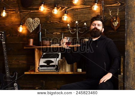 Relaxing Evening. Guy In Cozy Warm Atmosphere Drinking. Man Bearded Enjoy Evening With Warming Bever