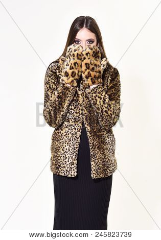 Winter Fashion And Beauty. Woman In Leopard Fur Coat Isolated On White. Look Of Fashion Model With B