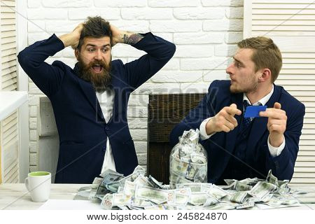 Business Partners, Businessmen At Meeting In Office. Bearded Boss Shocked And Colleague With Cash An