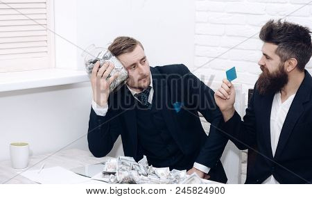 Manager With Beard And Colleague With Jar Of Cash And Card. Cash Issues Concept. Colleagues Collecti